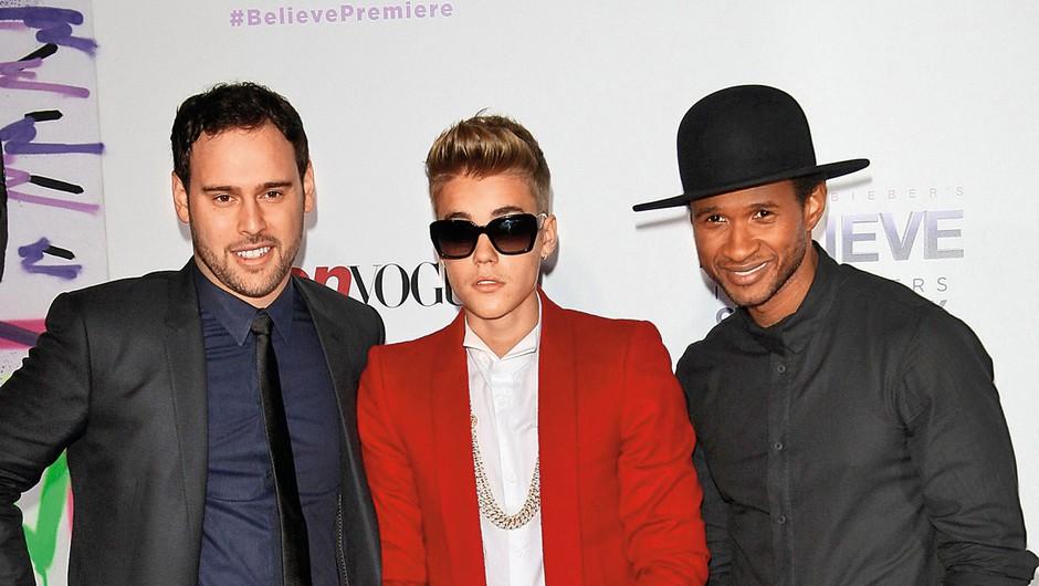 Scooter in njegov poslovni  partner Usher sta Bieberja pod svoje okrilje vzela kot 13-letnega fantiča.   (foto: Profimedia)
