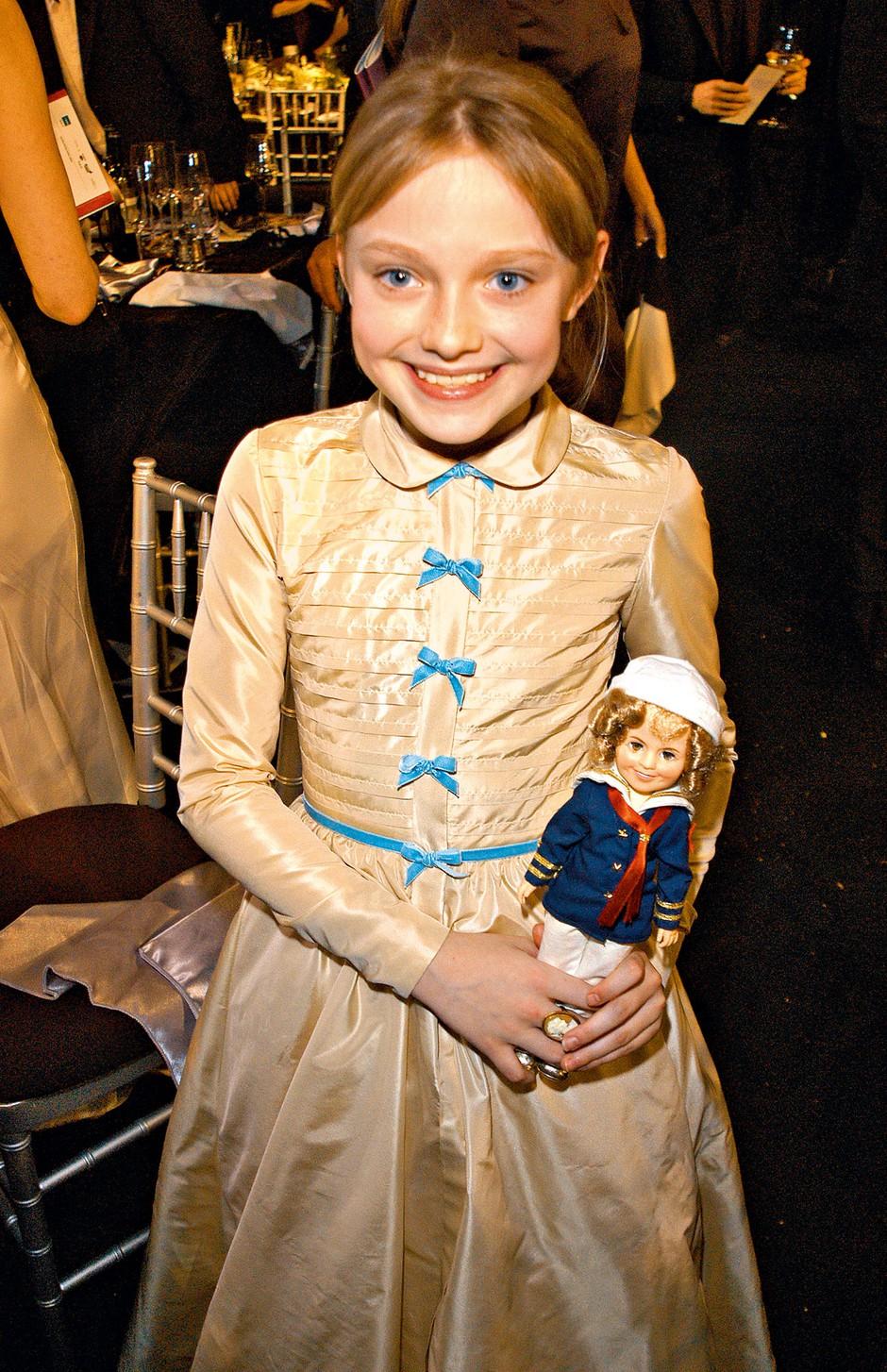 Osvojila je kar tri priznanja Young Artist Award, zadnjega leta 2009, in sicer za vlogo Lily Owens v drami Skrivno življenje čebel, v kateri ji je družbo delala Queen Latifah. (foto: Profimedia)