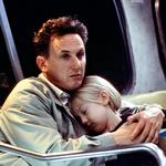 Zaslovela je z vlogo Lucy Diamond Dawson v drami Moje ime je Sam, v kateri je njenega očeta igral Sean Penn. (foto: Profimedia)