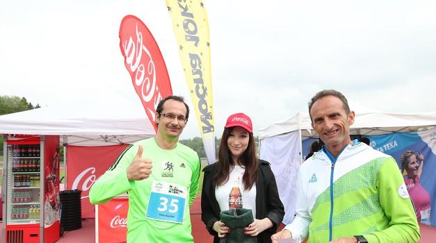 Roman Kejžar(desno) pod okriljem projekta Moja olimpijska norma spodbuja udeležence k teku. (foto: Aleš Fevžer)